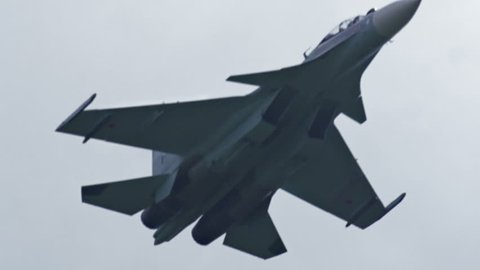 Fighting falcon. Russian fighter aircraft in slow motion. Close-up of an airplane. Russian and US Army. A military plane is flying in the sky. Hostilities. Bomber craft in slow motion.