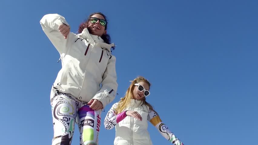 BANSKO, BULGARIA - circa FEB, 2017: Ski and dancing girls having fun at party in Bansko ski resort