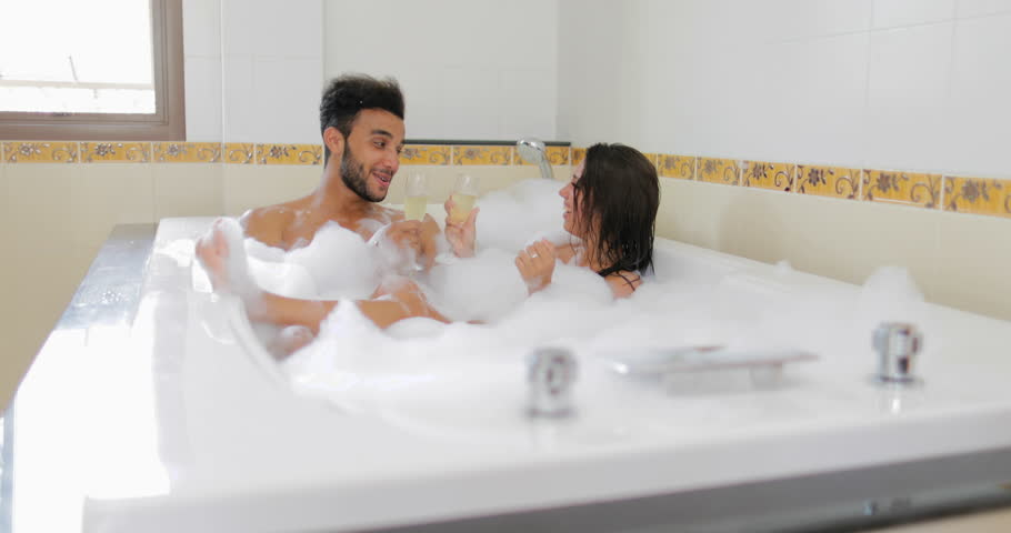 Young Couple In Bath Together Drink Champagne Talking, Man
