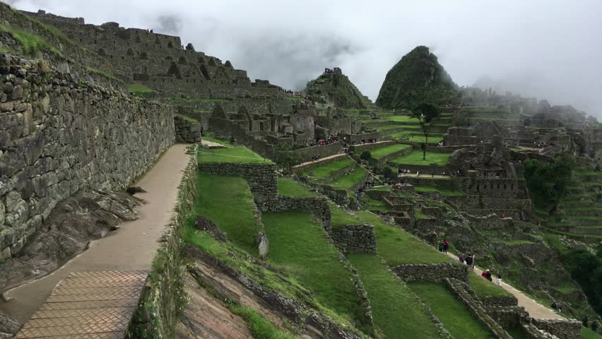 Machu Picchu, the most familiar icon of Inca civilization. Machu Picchu is a 15th-century Inca citadel situated on a mountain ridge above the Sacred Valley northwest of Cuzco, Cusco Region, Peru.
