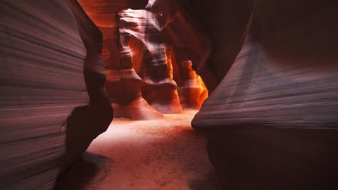 a zoom in shot of the brightly colored sandstone walls of upper antelope canyon in page, arizona
