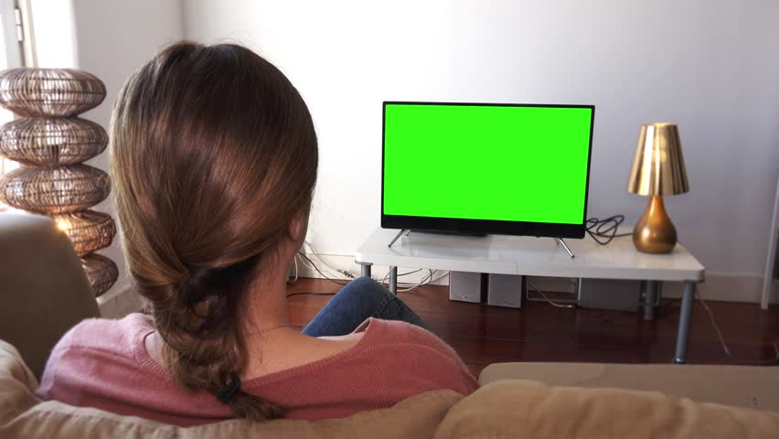 Watching Green Screen Television In Living Room Young Woman With Shot Behind Models Shoulders
