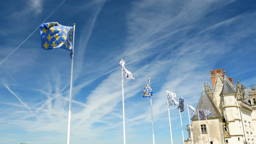 Royal Chateau de Amboise - Loire Valley - The royal Castle of Amboise located in  Indre-et-Loire department Loire Valley in France majestic flags heraldry Fleur de Lis and Ermine against dramatic sky
