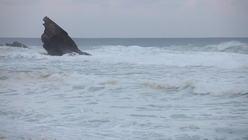 Big stormy waves beside the rocky cliff. Atlantic ocean coastline | Shutterstock HD Video #26888755