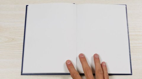 Top view of the opening blank book. Opening a book with blank pages.