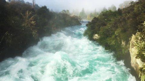 Wild rushing stream of Huka Falls near Lake Taupo in the North Island of New Zealand