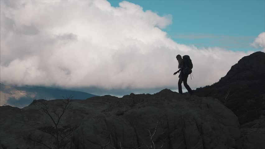4K shot of hiker walking on a mountain ridge in Patagonia | Shutterstock HD Video #26911642