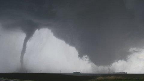 Dual tornadoes sweeping across farmland near Wakefield, Nebraska
