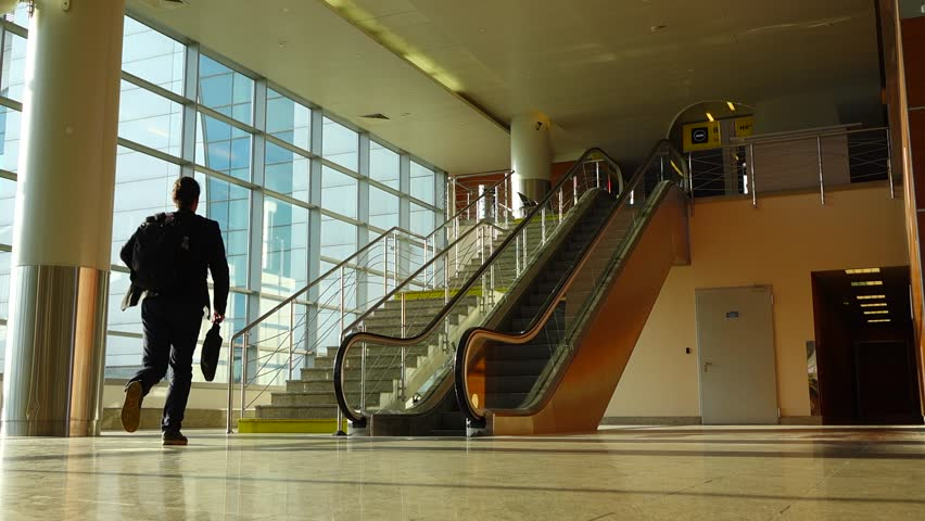 Hd00:18Man Run Back To Upstairs Of Beside An Escalator In Airport  Passageway, Hurry Up, Slow Motion Shot. Empty Passage Between Local And  International ...
