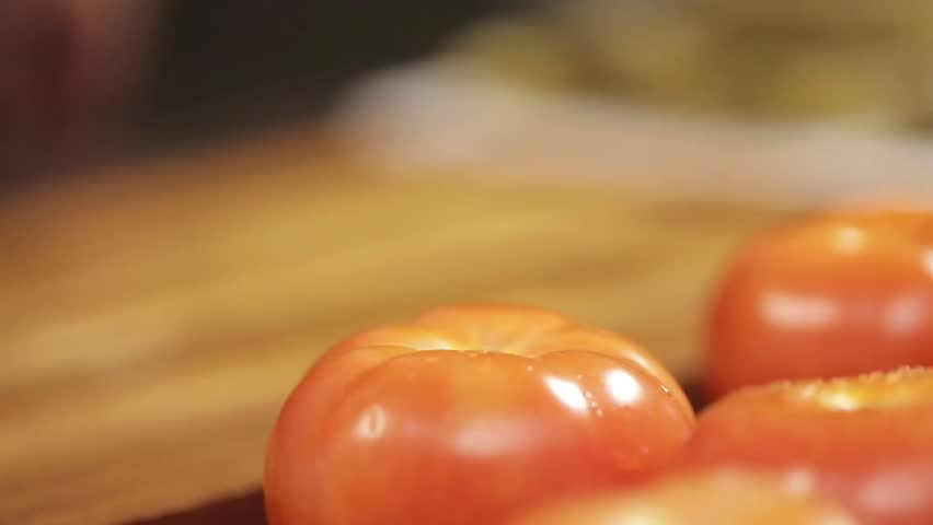 Tomato - Cutting A Tomato on Wood - Complete Process - Side Angle 2 | Shutterstock HD Video #26972182