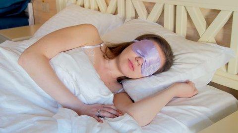 Closeup 4k video of sleeping young woman wearing blindfold mask