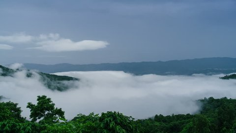 Time Lapse Mist Moving Over The Green Mountain at Phu Chee Pha. Chiang Rai Province. Thailand