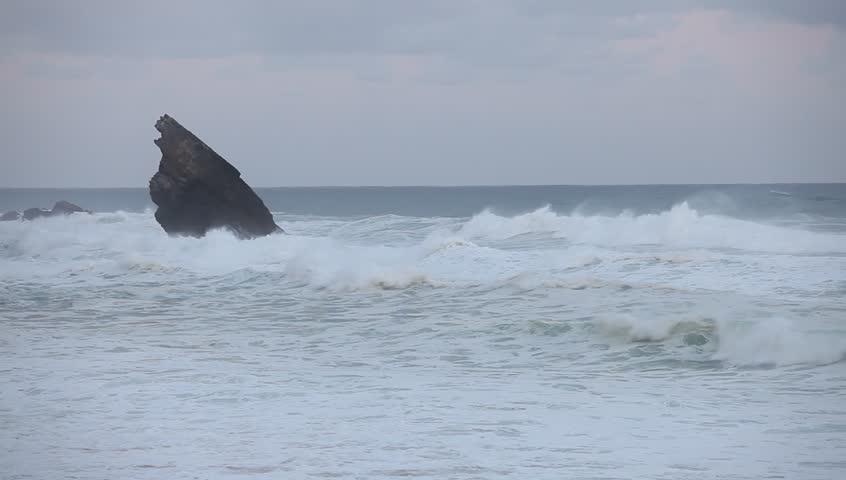Stormy waves beside the rocky cliff. Atlantic ocean coastline, Portugal #26992042