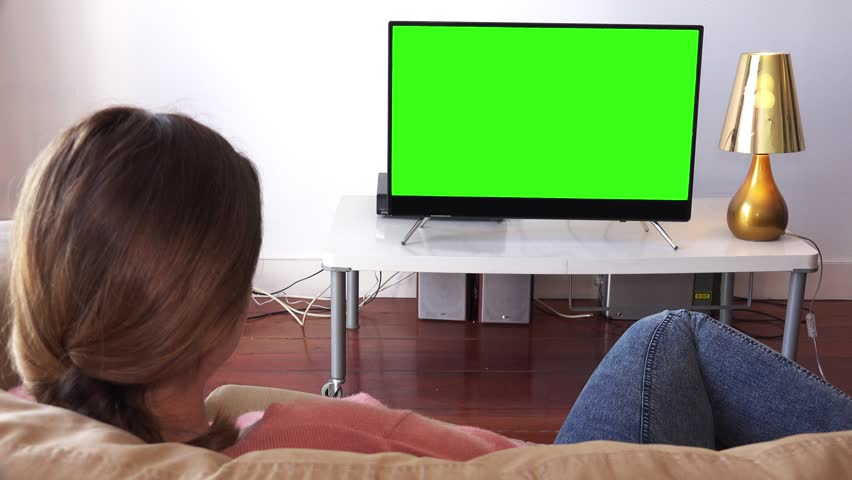 girl watching television  Stock video of girl comfortably lying on couch watching | 28562542 ...