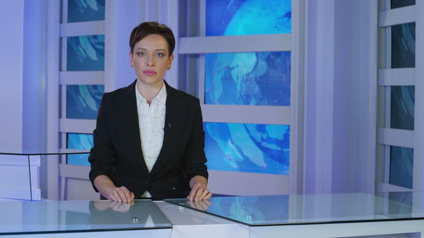 News reporter talking in studio.  | Shutterstock HD Video #27003022