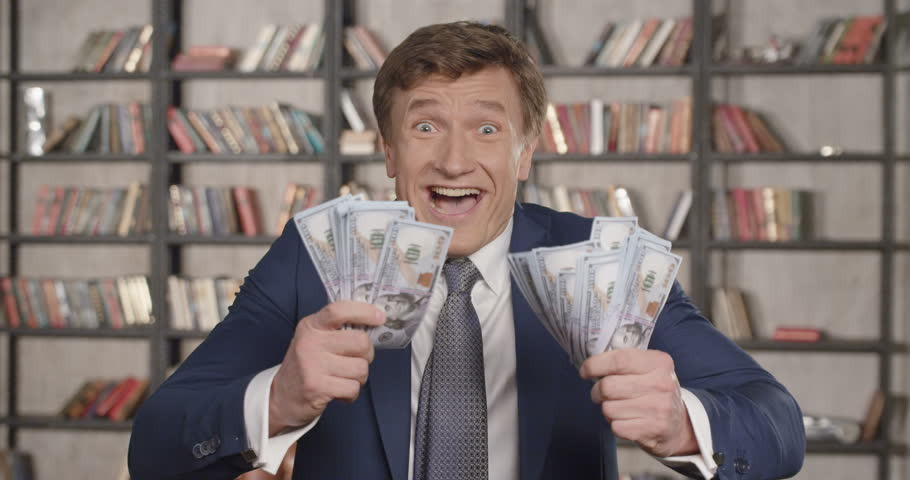Great Winning! Slow Motion Portrait of Very Happy Successful Cheering Man Throwing Money Up, Rising Hands Celebrating His Successful Win With a Lot of Dollars. Businessman Series. 4K UHD 4096x2160. | Shutterstock HD Video #27031117