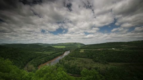 Beautiful time lapse of the view the Appalachian mountains and Potomac River of West Virginia, Pennsylvania, and Maryland as clouds float over the