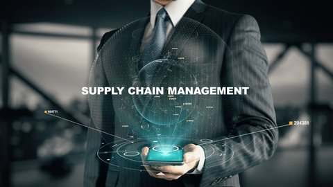 Businessman with Supply Chain Management hologram concept