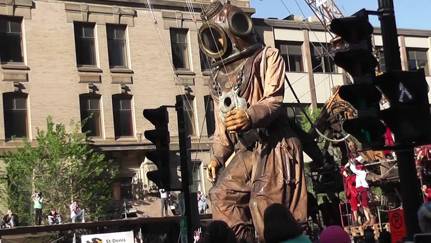 May 19-21, 2017: The giant deep-sea diver walking toward the street of Montreal, Quebec, where he will meet his niece.  The Giants were in Montreal to celebrate Montreal's 375th anniversary.