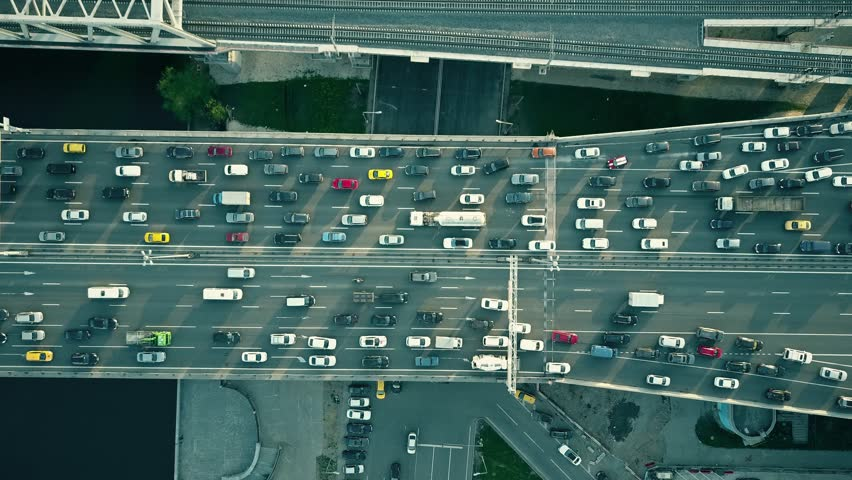 Aerial top down view of traffic jam on a car bridge and moving train. 4K video | Shutterstock Video #27076756