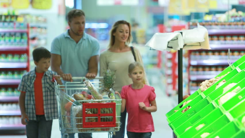 Family stopping by a vegetable section to take fresh cabbage | Shutterstock HD Video #2707763