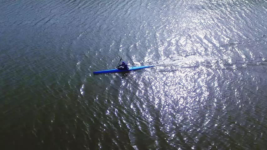 A kayak athlete moves on a water surface. Aerial view | Shutterstock HD Video #27087412