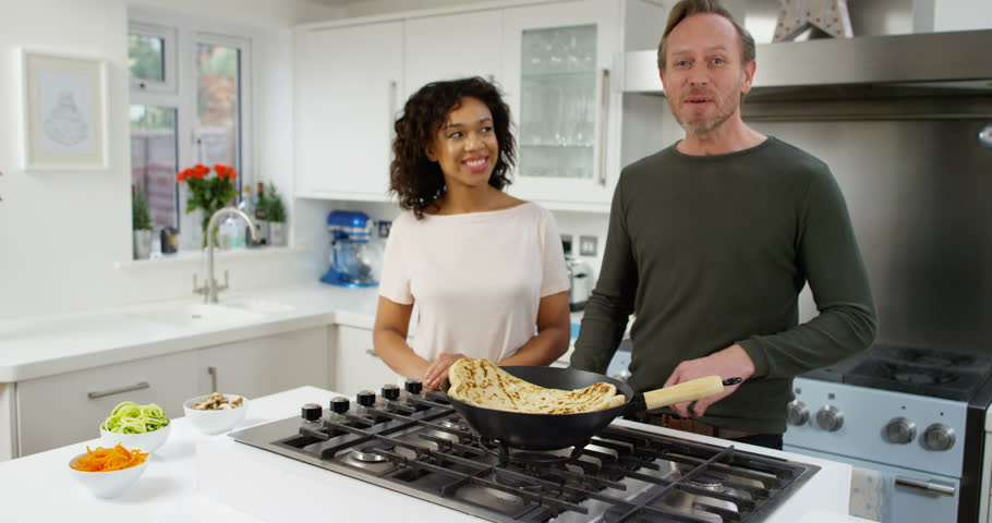 4K Cheerful Couple Cooking Together With Man Explaining His ...