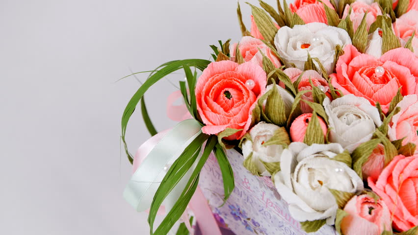Close-up, view from above, Top view, Gift box with artfully made paper flowers of white and peach color, rotation on a white background. | Shutterstock HD Video #27111442