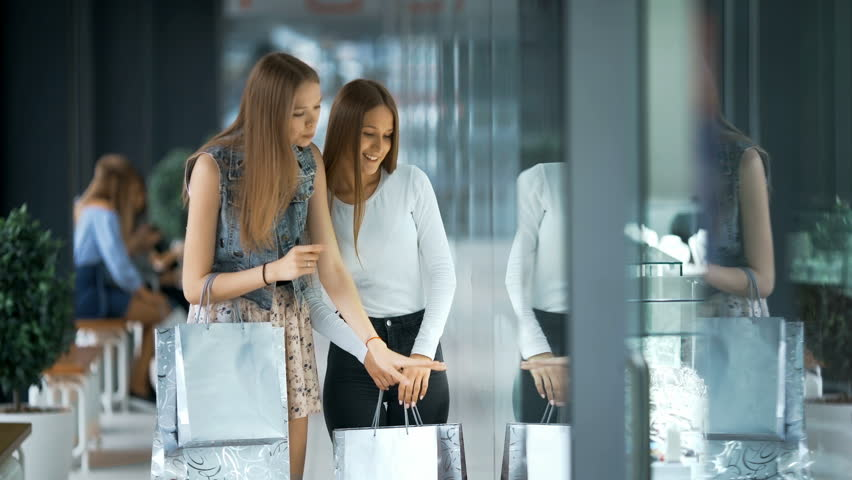 Two beautiful women shopping and looking at storefronts | Shutterstock HD Video #27205102