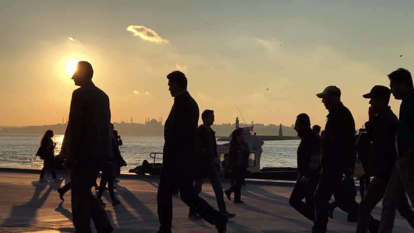 MAY 18,2017 ISTANBUL.Rush hour at Kadikoy pier in Istanbul.Unidentified people walks to the both metro and ferryboat to get back,during sunset time.Timelapse footage.