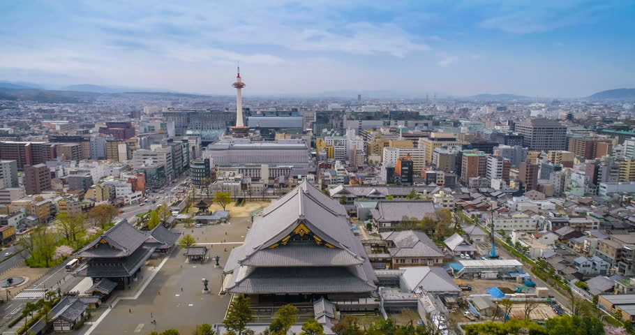 Aerial shot above buddhist temple in Kyoto with city skyline and blue sky, Japan | Shutterstock HD Video #27233632