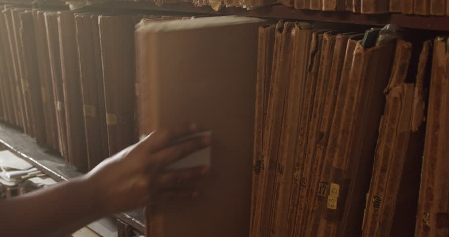 Man puts a folder on it's place in shelf in print house   Shutterstock HD Video #27234232