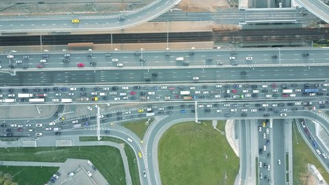 Aerial top down view of traffic jam on a car road in the rush hour. 4K video