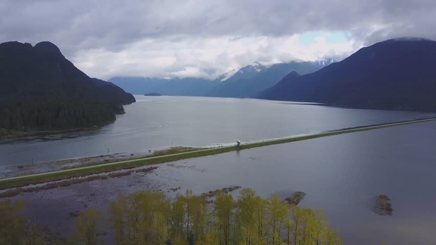 Aerial footage of Pitt Lake in Pitt Meadows, Greater Vancouver, British Columbia, Canada. Taken during a cloudy spring morning.
