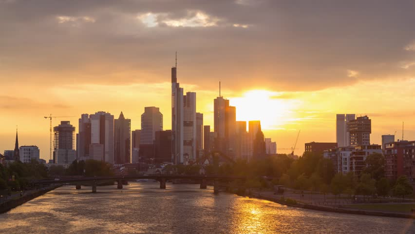 Frankfurt, Germany - April 2017: Beautiful sunset over the city and Main river