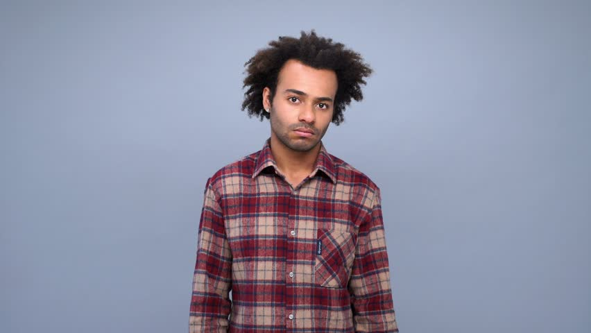 Young african man wearing checkered shirt scratching his head and don't know what to do isolated