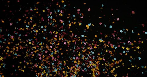 Confetti Falling against Black Background, Slow Motion 4K