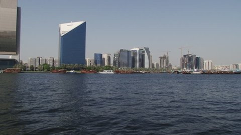 DUBAI, UAE - CIRCA 2008: Pan-right shot of Dubai cityscape seen across the Creek. Dubai's saltwater creek is one of the main arteries of transport and is a main tourist attractions.