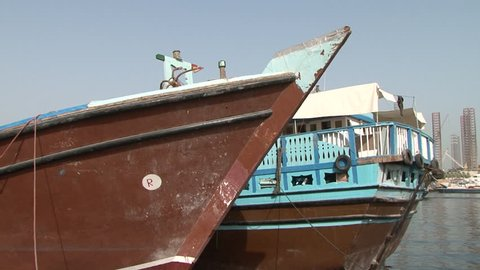 DUBAI, UAE - CIRCA 2008: Pan-right shot of dhows wharfed at Deira harbour. Dhow wharfage is listed as a tourist attraction in the UAE.