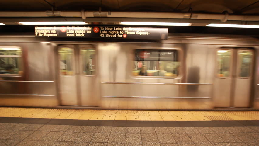 NEW YORK, NEW YORK/USA - May15, 2017: New York City subway train arriving metro Station Manhattan