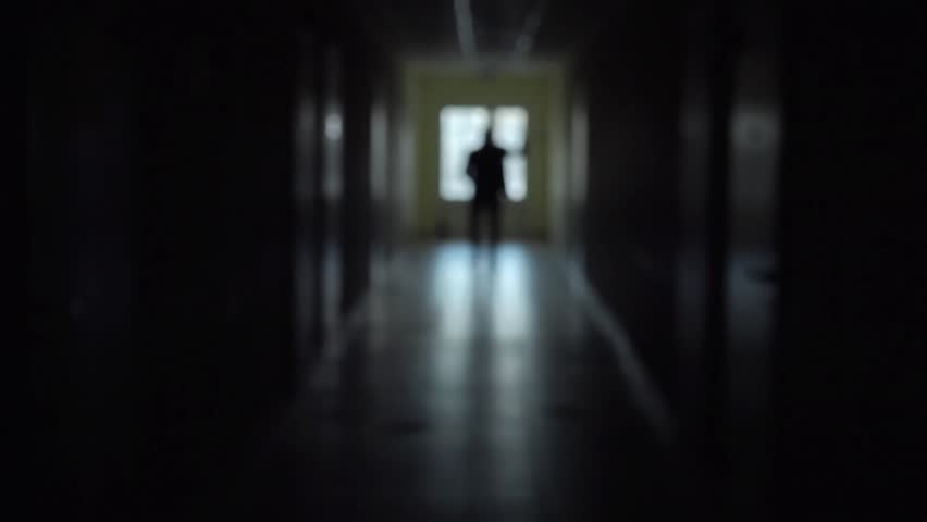 Good The Silhouette Of A Man Goes Through The Dark Corridor To A Bright Future.  The