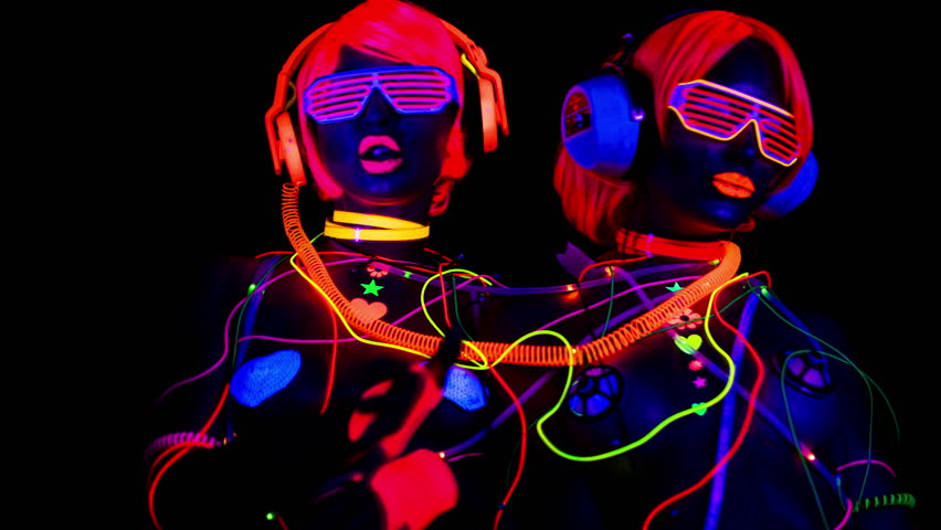 4k fantastic video of 2 sexy cyber glow raver women filmed in fluorescent clothing under UV black light