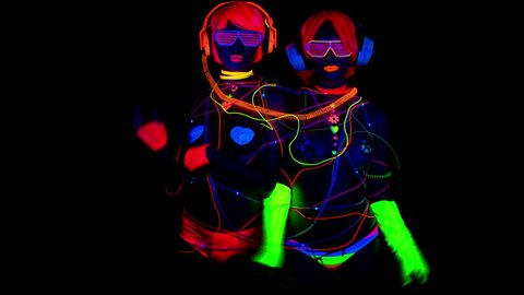 4k fantastic video of 2 sexy cyber glow raver women filmed in fluorescent clothing under UV black light
