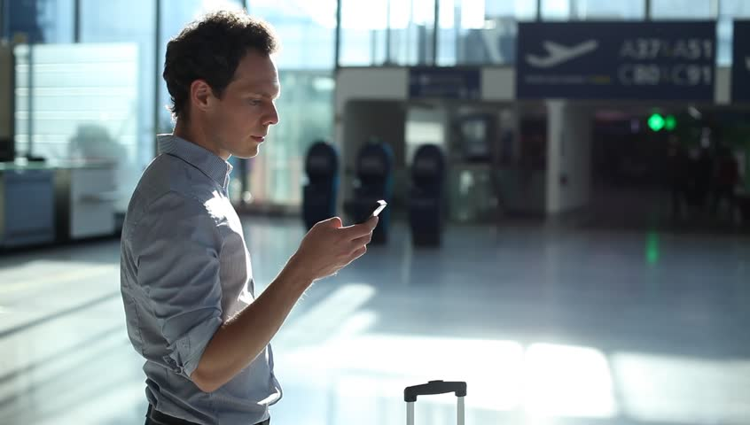 Man using smartphone in the airport | Shutterstock HD Video #27414511