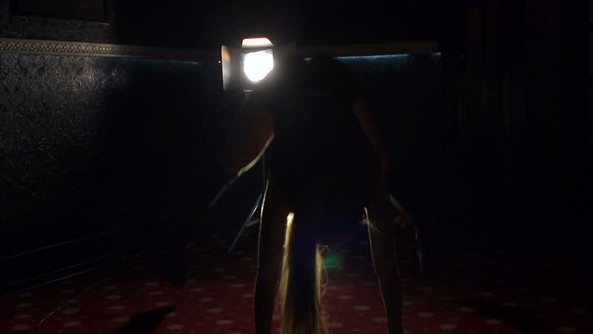 Silhouette of a girl who dances a striptease in the dark. Sexy girl dancing twerking, slow motion.   Shutterstock HD Video #27432082