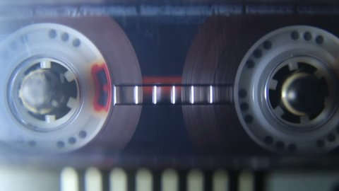 Vintage audio cassette tape playing, macro