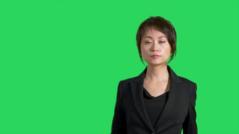 Chinese news reporter or presenter on green screen showing product or weather space
