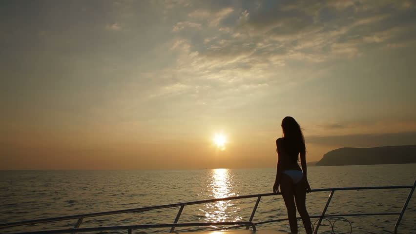Bikini Female Silhouette on Yacht at Sunset