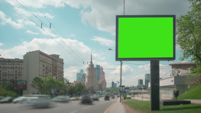 Time Lapse. A Billboard with a Green Screen on a Busy Street. #27517942