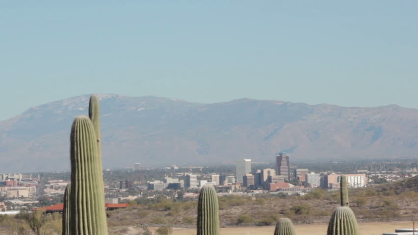 Downtown Tucson and sprawling metro area with Saguaro cacti in the foreground